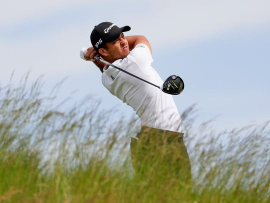 Xander Schauffele plays a shot from the fifth tee during