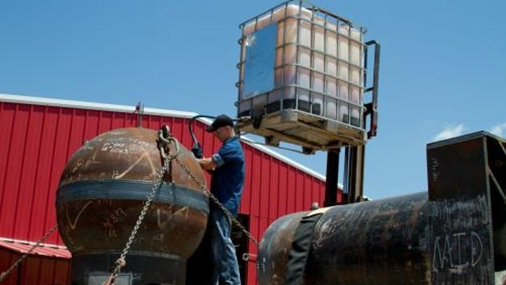 Nathan McQuinn, an employee at Tilley Pressure Test, performs a CNG Tank Leak Test on a Wilco Tank.