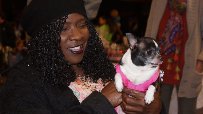 Gerri Hover and Bellja pose for a photo at the Tally Top Pet kickoff event in 2015.