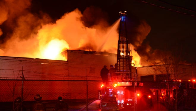 A massive fire at a warehouse on Hamilton in Highland Park is seen in the early hours of Wednesday, Feb. 3, 2016.