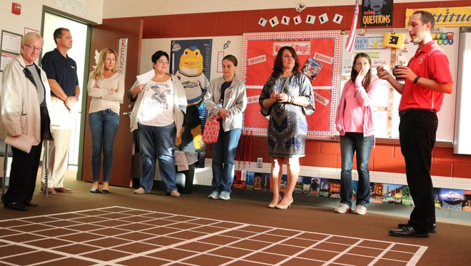 Ryan Evarts, right, a social studies teacher at Port Clinton Middle School, converted his classroom into a giant 'battleship' game to teach about latitude and longitude. Port Clinton voters approved a 2.79-mill school levy renewal on Tuesday.