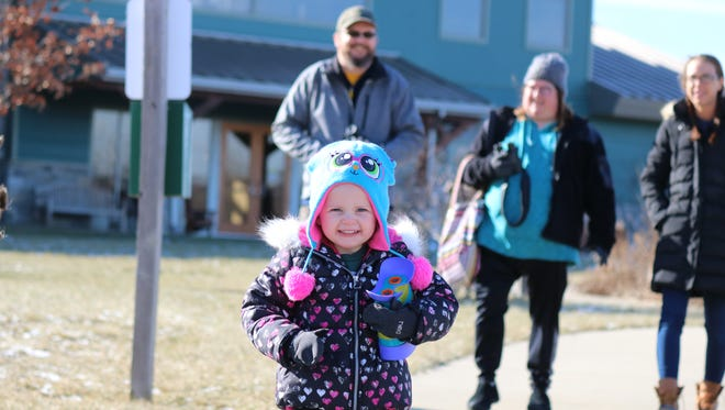 Evie Miller, 3, of Elmore, goes for a hike at the Ottawa National Wildlife Refuge as part of their 'Nature Tots' program on Saturday.