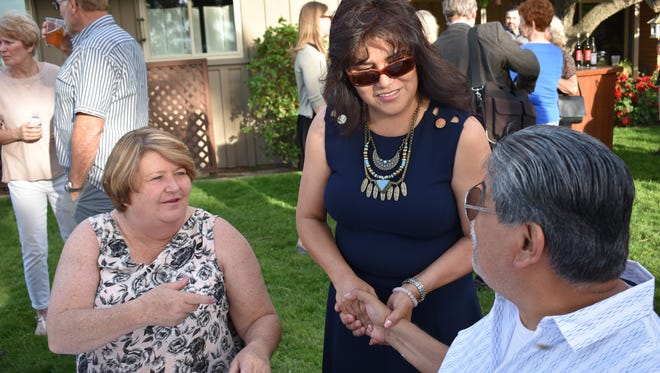 Tulare Regional Medical Center Board of Directors' candidate Senovia Gutierrez, middle, at a fundraiser event.