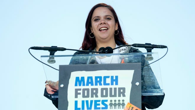 """Samantha Fuentes, a survivor of the mass shooting at Marjory Stoneman Douglas High School in Parkland, Fla., speaks during the """"March for Our Lives"""" rally in support of gun control in Washington on March 24, 2018. Fuentes, who gave emotional speeches at the March for Our Lives in Washington, has something to celebrate: Three months after the attack, she says """"My face is finally shrapnel free!"""" Fuentes tweeted a photo of her face on Saturday, May 12, 2018, showing a wide smile despite bruises and a hospital bandage stretching from her ear to her mouth."""
