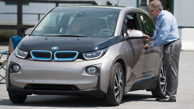Richard Johnson, director of business development with Auto Port Inc., lets people test drive an electric BMW i3 at the alternative fuels workshop at Dover Downs Casino in Dover.