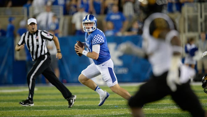 QB Drew Barker scrambles out of the pocket during the University of Kentucky football game against Southern Mississippi at Commonwealth Stadium in Lexington, KY on Saturday, September 3, 2016.