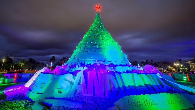 """HOLIDAY IN PARADISE / SANDI LAND - Adding a tropical twist to the holiday season, The City of West Palm Beach has created the world's only 35-foot-tall tree made of 600 tons of sand. Affectionately named """"Sandi,"""" the famed tree is strung with more than 5,000 real lights and is meticulously sculpted.Thesculpting and preparation of a synchronized light show all lead up to the Holiday Tree Lighting on Thursday, Nov.30 during Clematis by Night.featuring a variety of entertainment. Special hours are from 6to 9:30 p.m., with 7p.m. designated for theLighting of Sandi.For more information,visitwww.wpb.org/events."""
