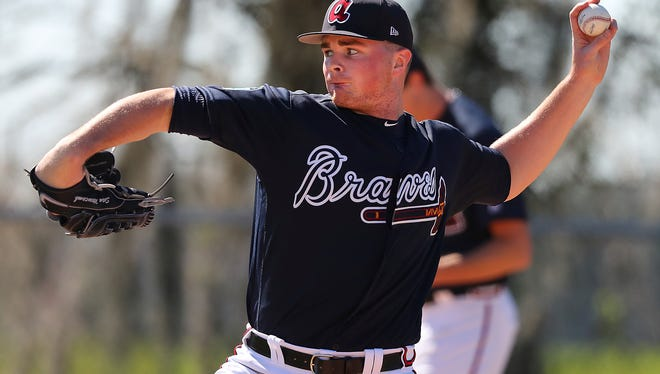 Atlanta Braves pitcher Sean Newcomb delivers a pitch during spring baseball training in Lake Buena Vista, Fla., Thursday, Feb. 16, 2017.