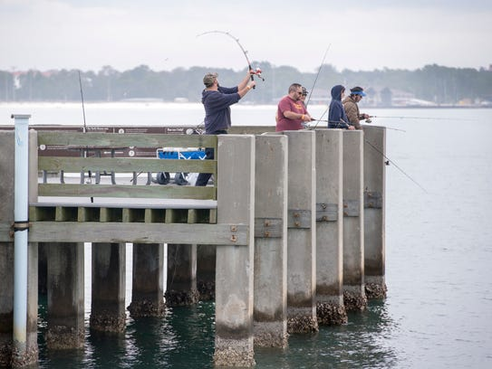 Anglers fish off the pier at Fort Pickens in Pensacola