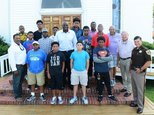 Attendees of a week-long boys camp pose for a group
