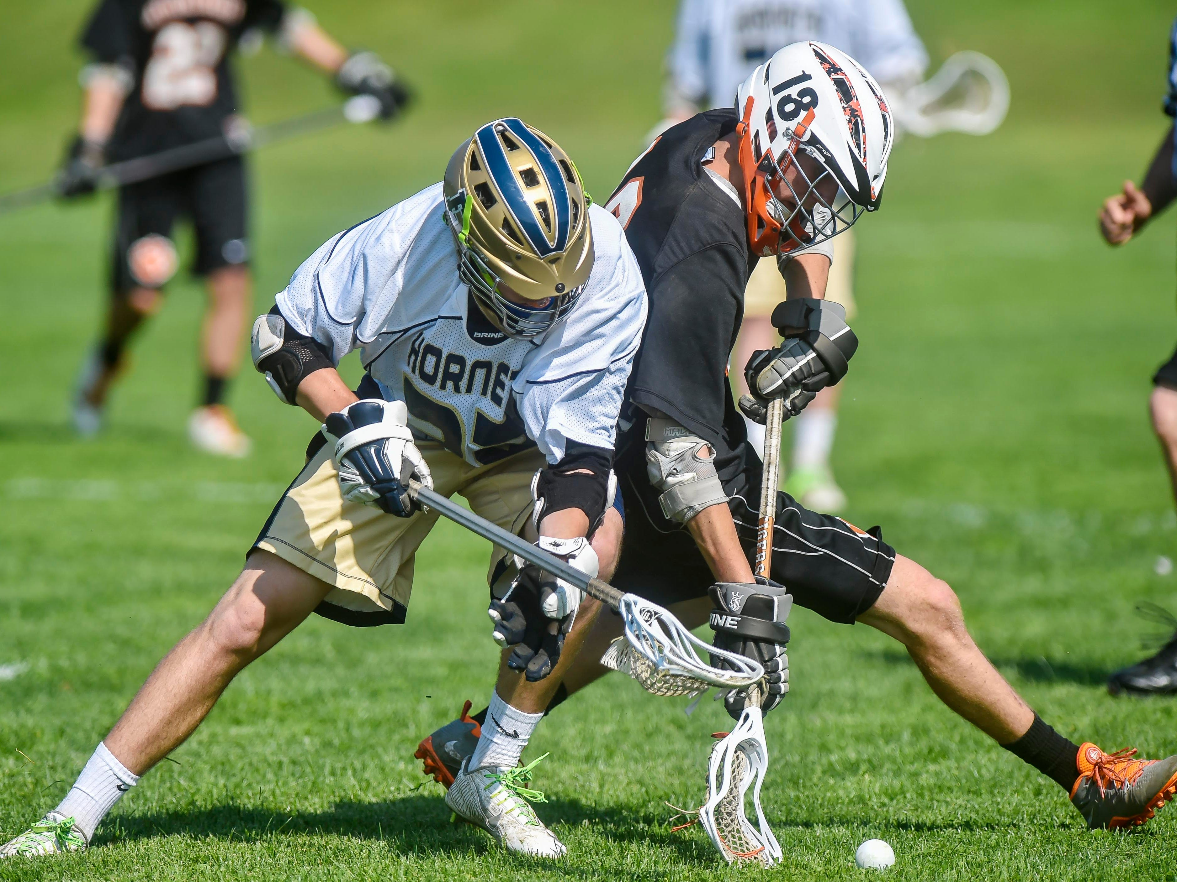 Essex's Noah Ferris, left, and Middlebury's Andrew Gleason dig after the ball during Tuesday afternoon's game in Essex.