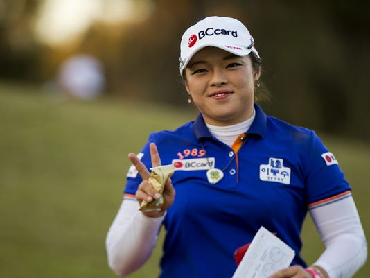 Ha Na Jang, of South Korea, smiles while walking off the eighth green during the second round of the LPGA's Coates Golf Championship, Thursday, Jan. 29, 2015, in Ocala, Fla. (AP Photo/The Star-Banner, )