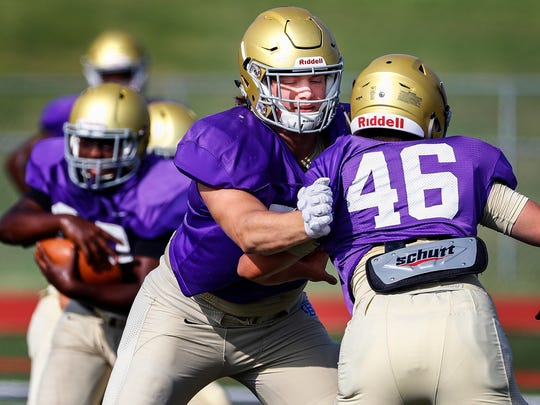 Christian Brothers High School 4-star lineman Bill Norton (middle) makes a block during the first day of fall camp.