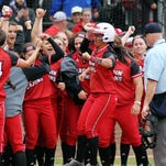 UL players celebrate as Samantha Walsh arrives after hitting a solo home run against Iowa in an NCAA softball game Friday, February 20, 2015, at Lamson Park in Lafayette, La.