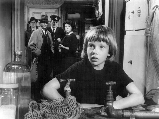 Hayley Mills with father John Mills in the background