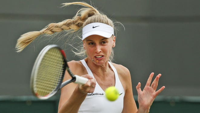 Naomi Broady of Britain plays return to Caroline Wozniacki of Denmark during their women's singles match at the All England Lawn Tennis Championships in Wimbledon, London, Wednesday, June 25, 2014.