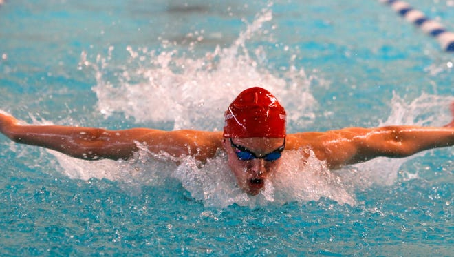 Austin Haney of Beechwood High School competes in the butterfly in January of 2014.