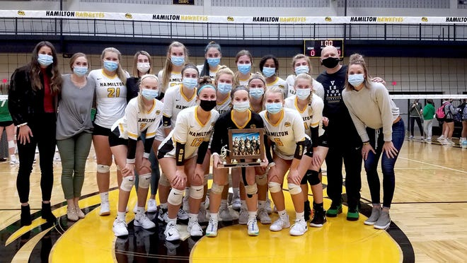 The Hamilton volleyball team celebrates after winning the OK Blue Conference championship with a win over West Catholic on Tuesday at Hamilton.