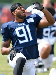 Titans linebacker Derrick Morgan (91) takes a drink during practice at Saint Thomas Sports Park Monday, July 30, 2018, in Nashville, Tenn.