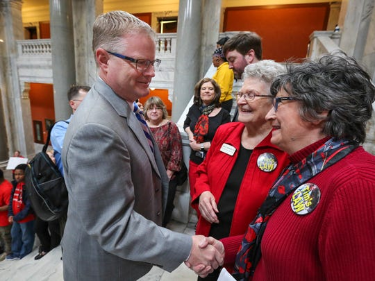 Senator Damon Thayer stops to shakes hands with Faye Morton.  Tim's Law is named for Morton's son.  Groups supporting Senate Bill 91, or Tim's Law, were on hand to urge support for overturning Governor Matt Bevin's veto.   The bill passed the House unanimously and only had three votes against it in the Senate.