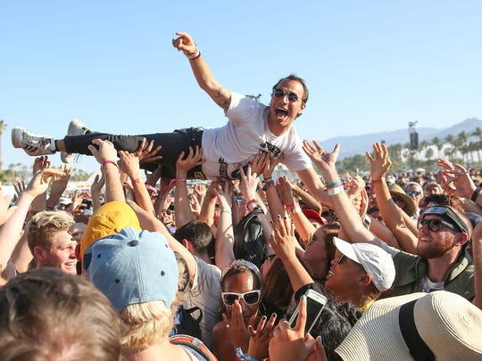 A man crowdsurfs during Mac DeMarco's set at the Coachella Festival, April 21, 2017.
