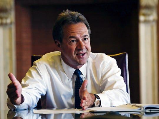 Gov. Steve Bullock vetoed two bills and signed 30 more into law on Thursday.