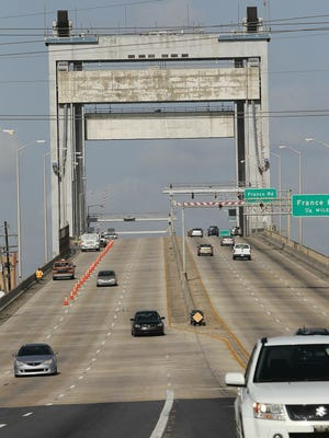 Cars pass over the Danziger Bridge in New Orleans. Five officers were sentenced this month in connection with the deadly shooting of six people on that bridge right after Hurricane Katrina.