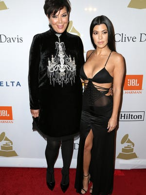 Kris Jenner, left, and Kourtney Kardashian attend the Clive Davis and The Recording Academy Pre-Grammy Gala at The Beverly Hilton Hotel on Saturday, Feb. 11, 2017, in Beverly Hills, Calif.