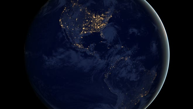 The black ball. Earth from space at night, showing the lights of North and South America.