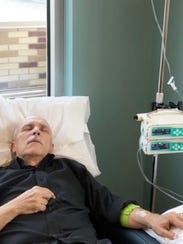 David Mitchell, founder of Patients for Affordable Drugs, is shown getting an infusion of drugs for his incurable blood cancer, multiple myeloma, last year.
