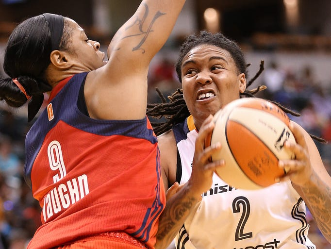 Erlana Larkins of the Fever tries to get to the basket against Mystics defender Kia Vaughn in the second quarter. The Indiana Fever hosted the Washington Mystics in WNBA action Friday May 23, 2014 at Bankers Life Fieldhouse in Indianapolis.