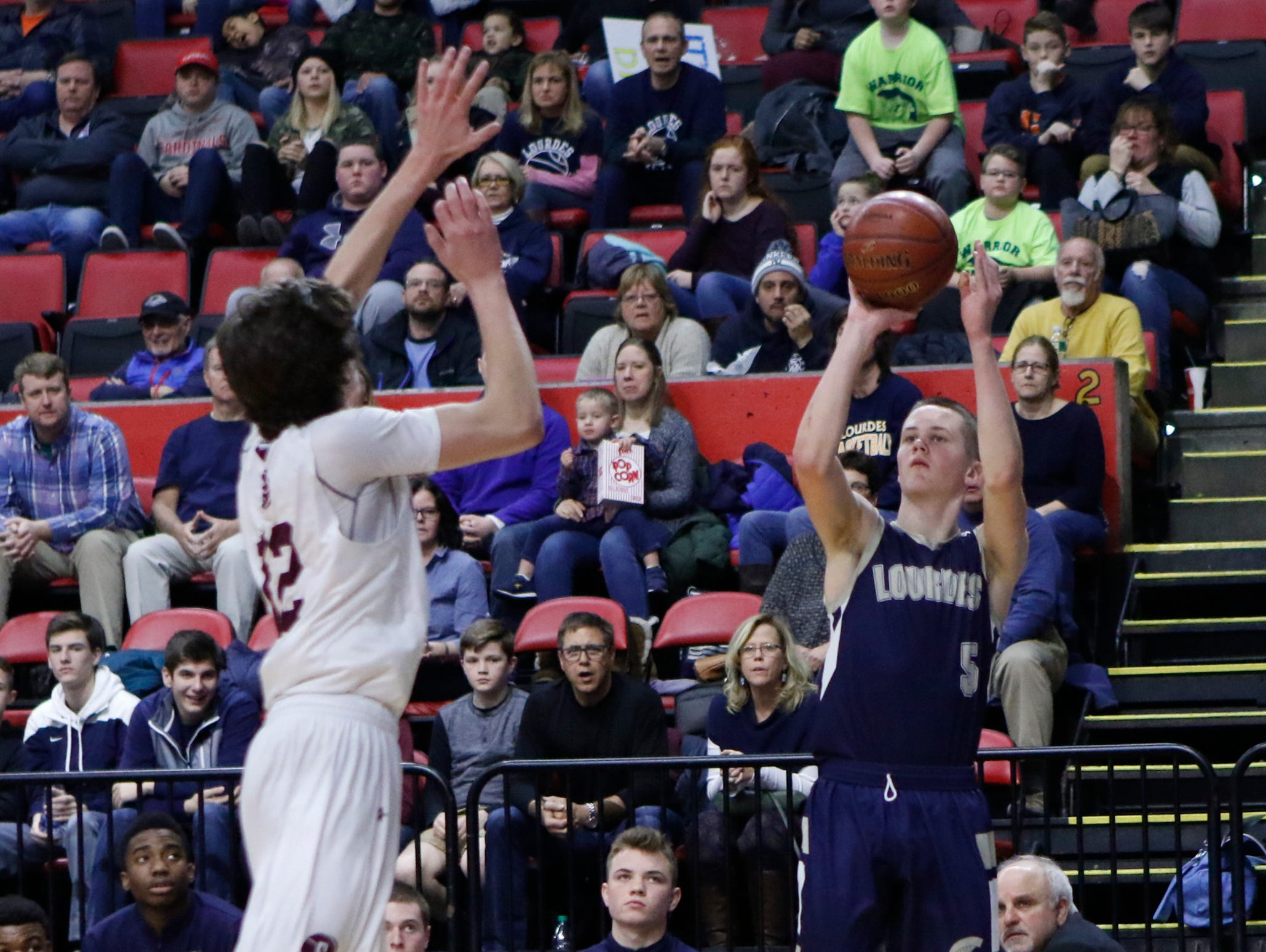 Our Lady of Lourdes's Aiden Hildebrand (5) throws up a 3-point shot during their 70-67 win over Southampton 70-67 in the NYSPHSAA boys Class A semifinal basketball game at Floyd L. Maines Veterans Memorial Arena in Binghamton on Saturday, March 18, 2017.
