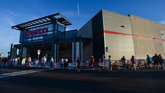 Shoppers line up in front of Costco in Bradenton at the start of  their grand opening on Wednesday. The 150,000-square-foot warehouse has everything from food and clothing to glasses and tires.
