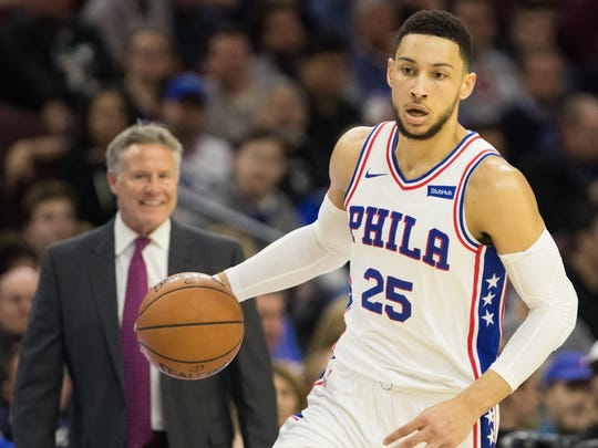 Feb 10, 2018; Philadelphia, PA, USA; Philadelphia 76ers guard Ben Simmons (25) dribbles past head coach Brett Brown during action against the LA Clippers at Wells Fargo Center. Mandatory Credit: Bill Streicher-USA TODAY Sports