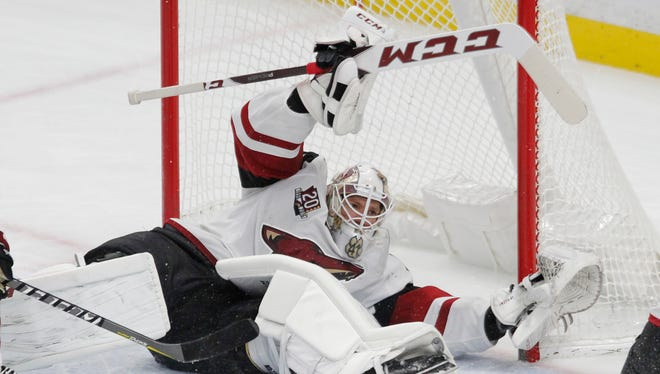 Arizona Coyotes goalie Mike Smith (41) sprawls for a save during the third period of an NHL hockey game against the Buffalo Sabres, Thursday, March. 2, 2017, in Buffalo, N.Y.