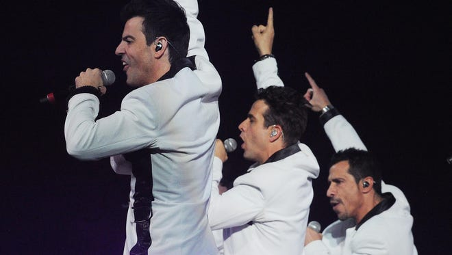 """New Kids on the Block perform during their 2013 """"The Package Tour"""" with Boyz II Men and 98 Degrees was at Bankers Life Fieldhouse."""