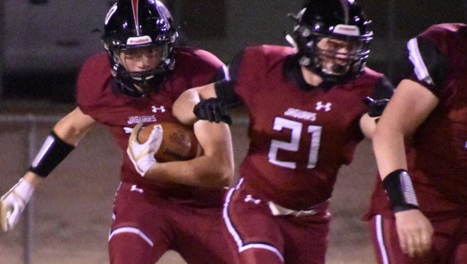Desert Ridge's Koby Hathcock (pictured with ball) will take his long-snapping skills to Iowa State.