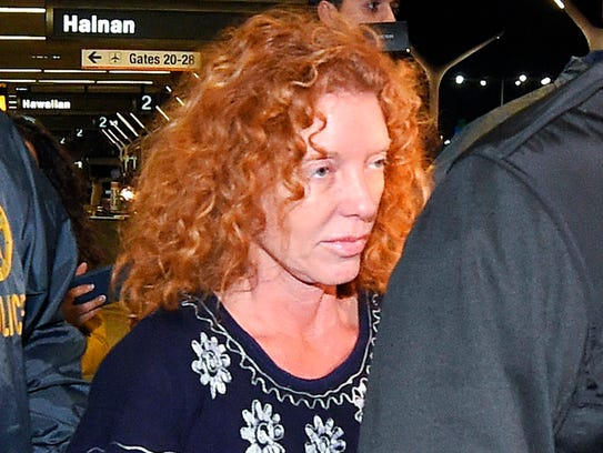 Tonya Couch is taken by authorities to a waiting car