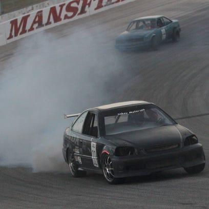 The asphalt track at Mansfield Motor Speedway will