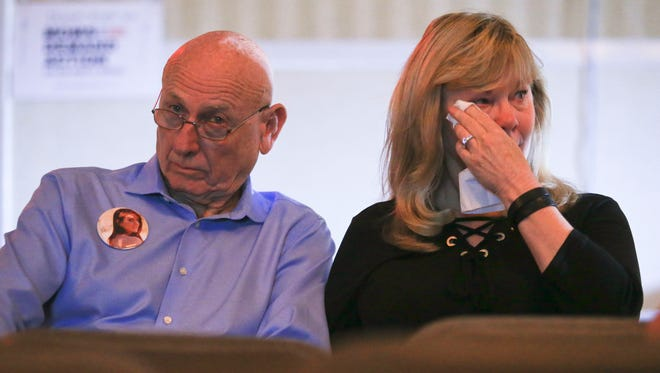 Sandy Phillips wipes away tears while watching the documentary Under The Gun with husband Lonnie during a Moms Demand Action rally Saturday morning downtown. Their daughter Jessica Ghawi was shot and killed during the 2012 Aurora, Colorado movie theater shooting by James Holmes. Quilts with patches representing and remembering gun violence victims were also on display.