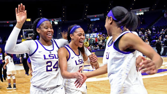 From left to right, LSU's Faustine Aifuwa, Ayana Mitchell and Khayla Pointer celebrate after an NCAA college basketball game against Tennessee, Sunday, Jan. 28, 2018, in Baton Rouge, La. (AP Photo/Bill Feig)