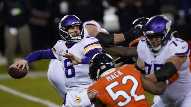 Minnesota Vikings quarterback Kirk Cousins throws during the first half of an NFL football game against the Chicago Bears Monday, Nov. 16, 2020, in Chicago.