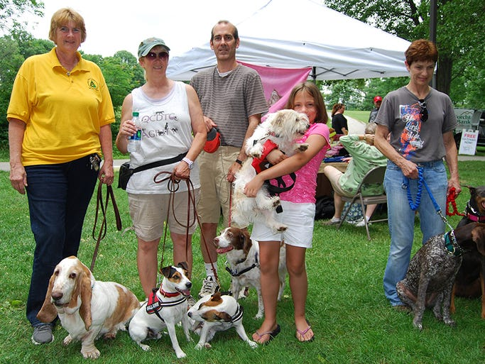 From left, Terri Ralenkotter of Walton, Laurie Delaney of Burlington, Laurie's brother Michael, Jessy Zimmer, 10, of Edgewood and Connie Sims of Hebron are pictured here with their dogs at the PetFest held Sunday, June 29, at Boone Woods Park.