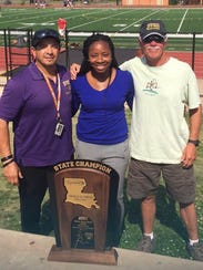 Byrd coaches Juan Plaza, . Janay McKie-Harshaw and