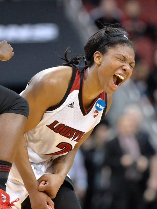 Louisville's Myisha Hines-Allen celebrates the team's 75-64 victory over Tennessee in a second-round game in the NCAA women's college basketball tournament, Monday, March. 20, 2017, in Louisville, Ky. (AP Photo/Timothy D. Easley)