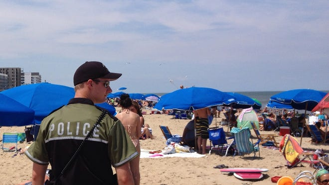 Seasonal officer Marc Glenn patrols the beach between Rehoboth and Brooklyn Avenues in Rehoboth Beach.