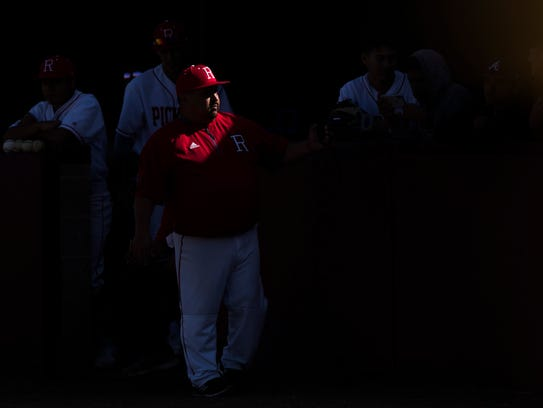 Robstown assitant coach Lee Roy Gonzalez talks to his