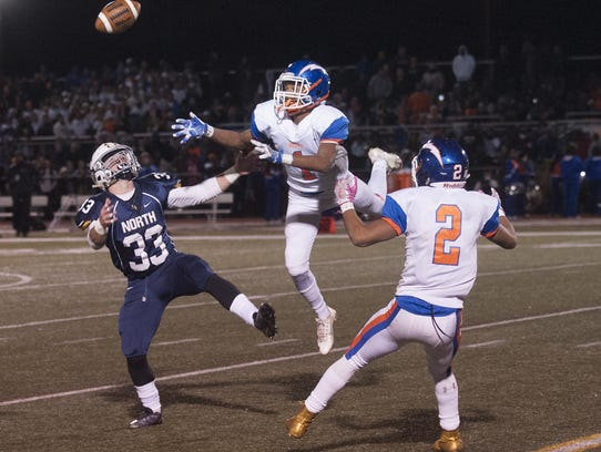 Millville's Carlton Lawrence , 1, and Marcial Ramos