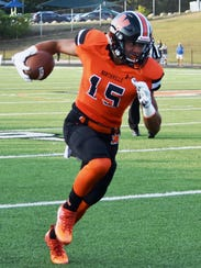 Northville's Andrew Fillman runs for daylight in a
