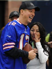 Former Buffalo Bills quarterback Jim Kelly and Bills co-owner Kim Pegula laugh just before announcing country music star Garth Brooks in Orchard Park on March 8, 2015.